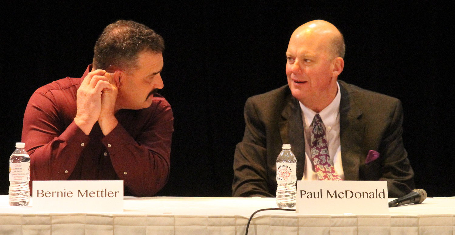 Candidates Bernie Mettler and Paul McDonald converse during last Thursday's political forum