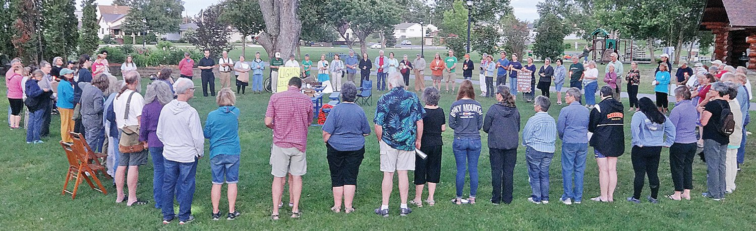 Dozens of concerned Ely-area residents joined a worldwide effort last Friday to draw attention to the plight of migrants. submitted photo