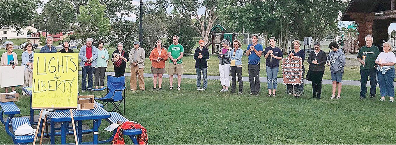 Ely-area residents gathered in Whiteside Park last Friday to join a worldwide effort to focus on the plight of migrants at the 