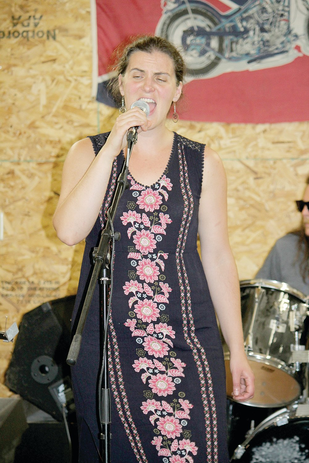 "Becky Frichek sings ""Ikwe"" during rehearsal for the War Bonnet set."