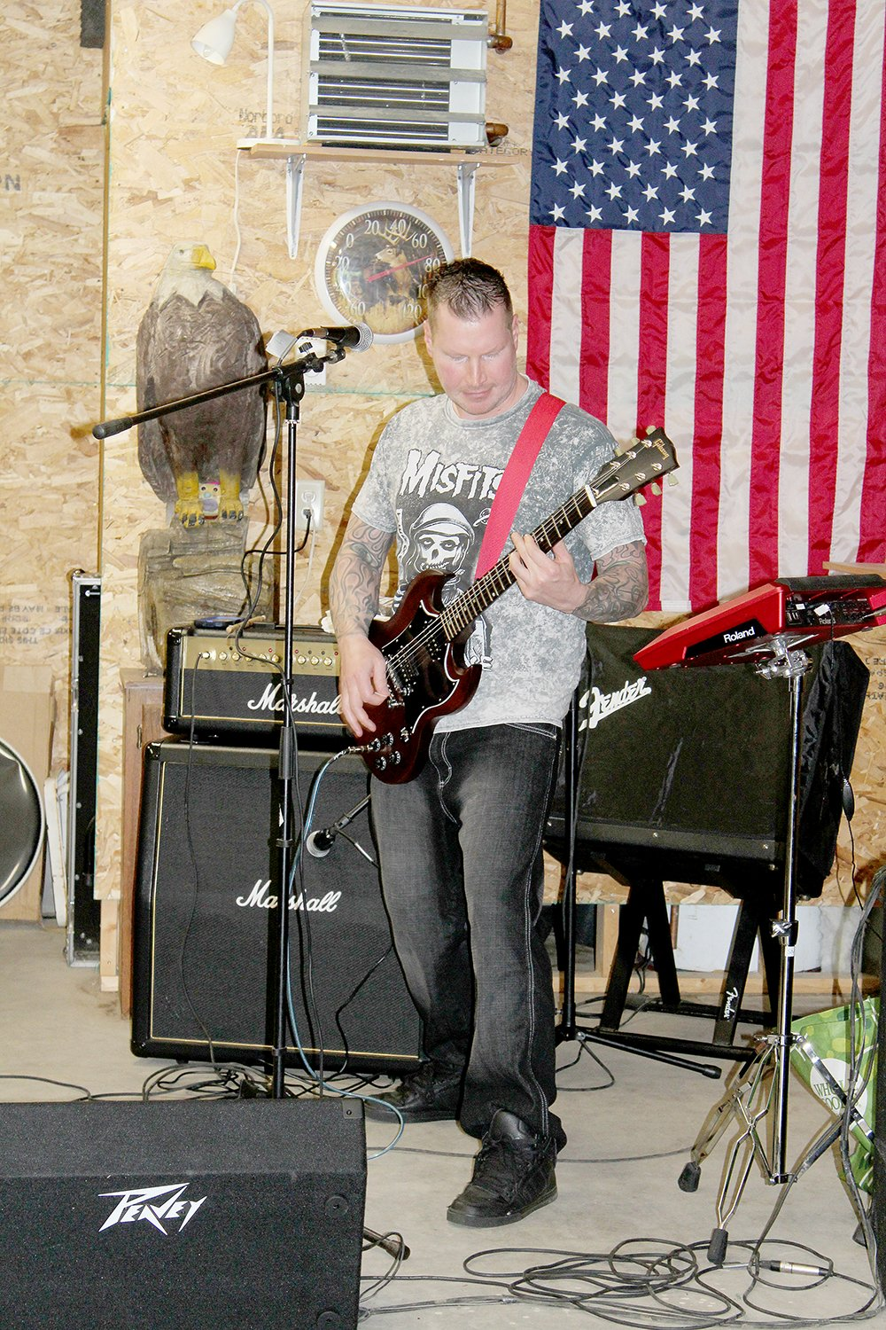 Chaz Wagner of War Bonnet plays rhythm guitar during a rehearsal on Sunday, Aug. 4 in Cook.
