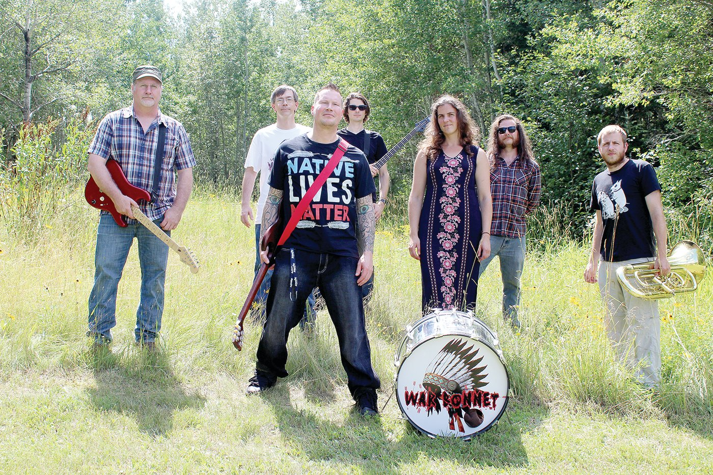 War Bonnet and their performance ensemble. Left to right are: Eric Krenz, Tony Parson, Chaz Wagner, Sean Zarn, Becky Frichek, Tom Frichek and Alex Mahne.