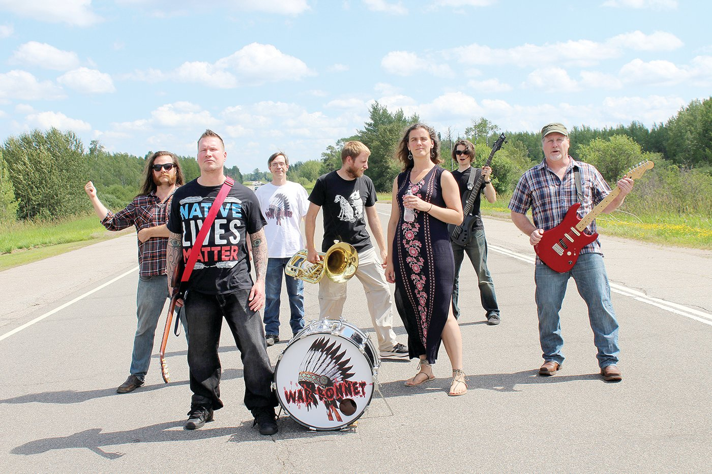 War Bonnet and their performance ensemble. Left to right are: Tom Frichek, Chaz Wagner, Tony Parson, Alex Mahne, Becky Frichek, Sean Zarn and Eric Krenz.