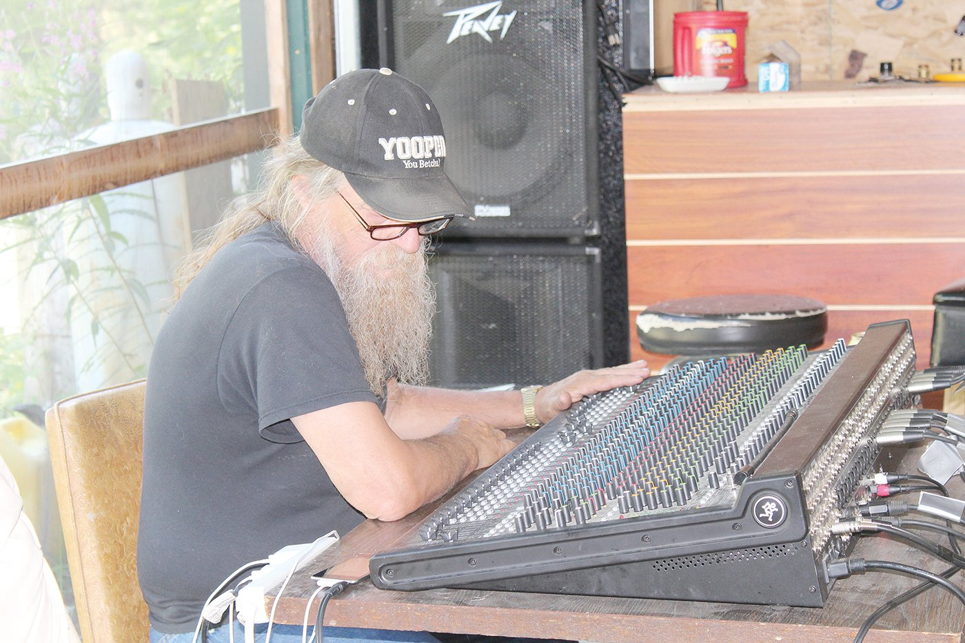 Sound technician John Young works the board at a War Bonnet rehearsal.