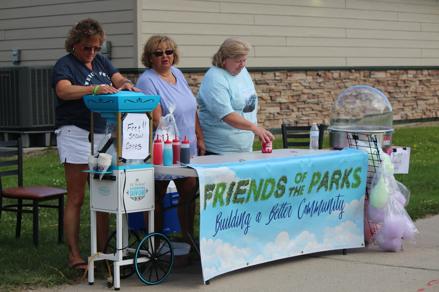 Diane Brunner, Sue Thomas and Carrolle Wood (left to right) offered guests free snow cones and cotton candy courtesy of Friends of the Parks.