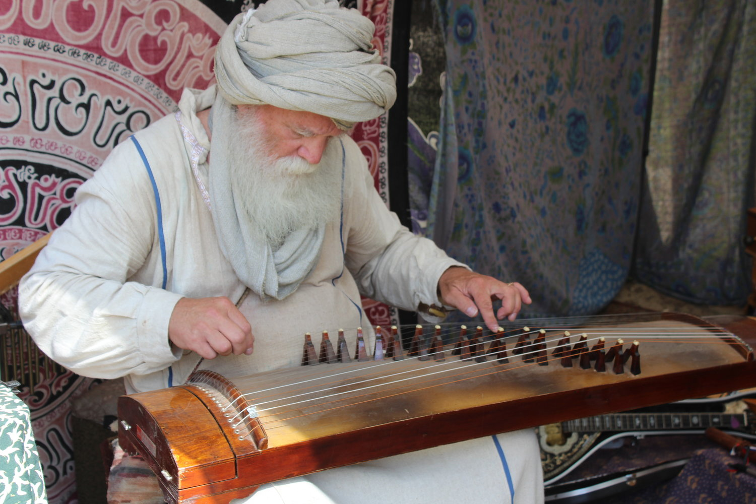 Mystic and musician Mustafa Ali performs on one of the dozens of instruments that he has gathered from around the world.