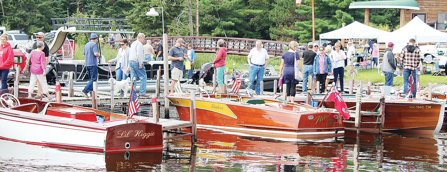 Crowds check out the lustrous boats at last year's show.
