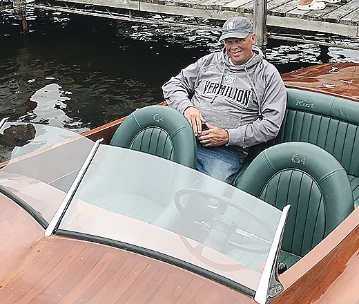 Chris Bullen relaxes in the back of his replica of a classic 1924 
