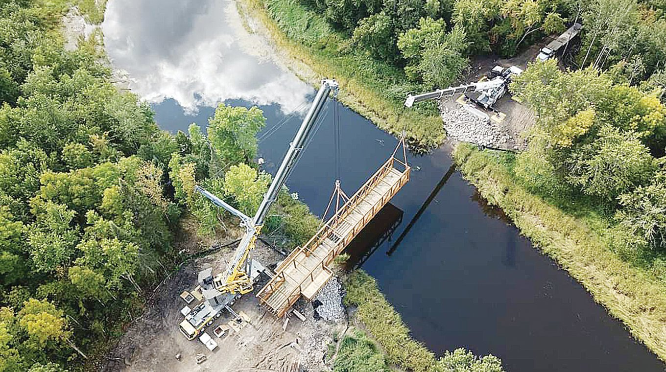 A 185-foot section of bridge was installed across the Vermilion River last weekend some 12 miles south of Crane Lake. The span completes a multi-use trail project in northwestern St. Louis County. A ribbon-cutting wil be held next Friday.