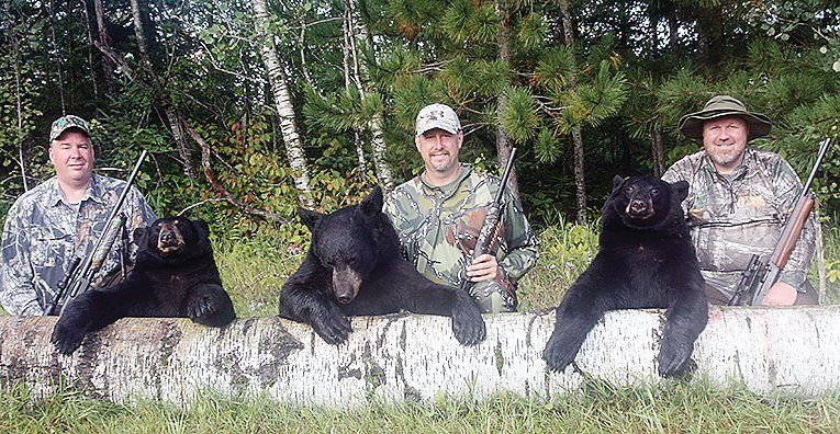 Three hunters from southern Minnesota pose with their bears, taken while hunting with Dennis Udovich of Udovich Guide 
