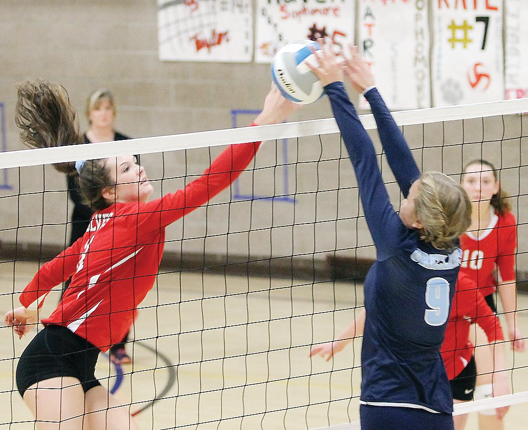 The Grizzlies' Coley Olson puts a block on a shot from Ely's Brielle Kallberg.