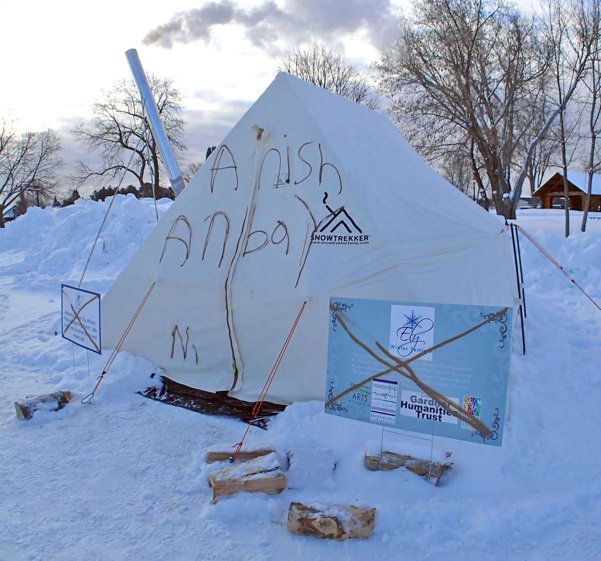 Spray paint damage mars a warming tent and sign in Whiteside Park.