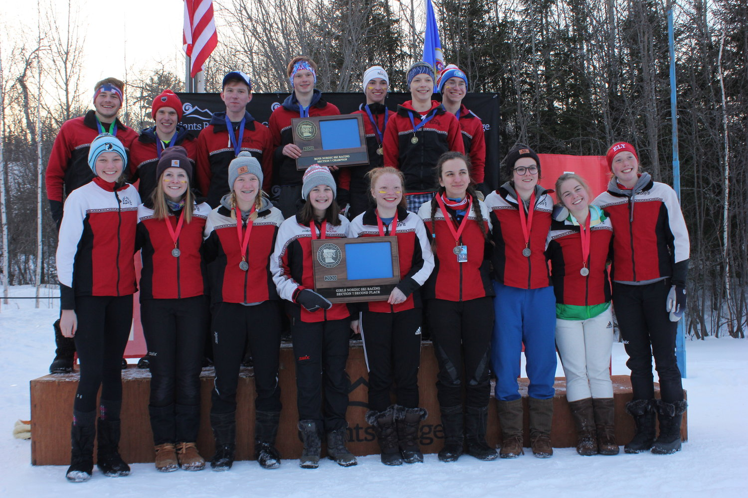 Ely Timberwolves Nordic skiers pose with the boys first place and girls second place plaques at the Section 7 meet.