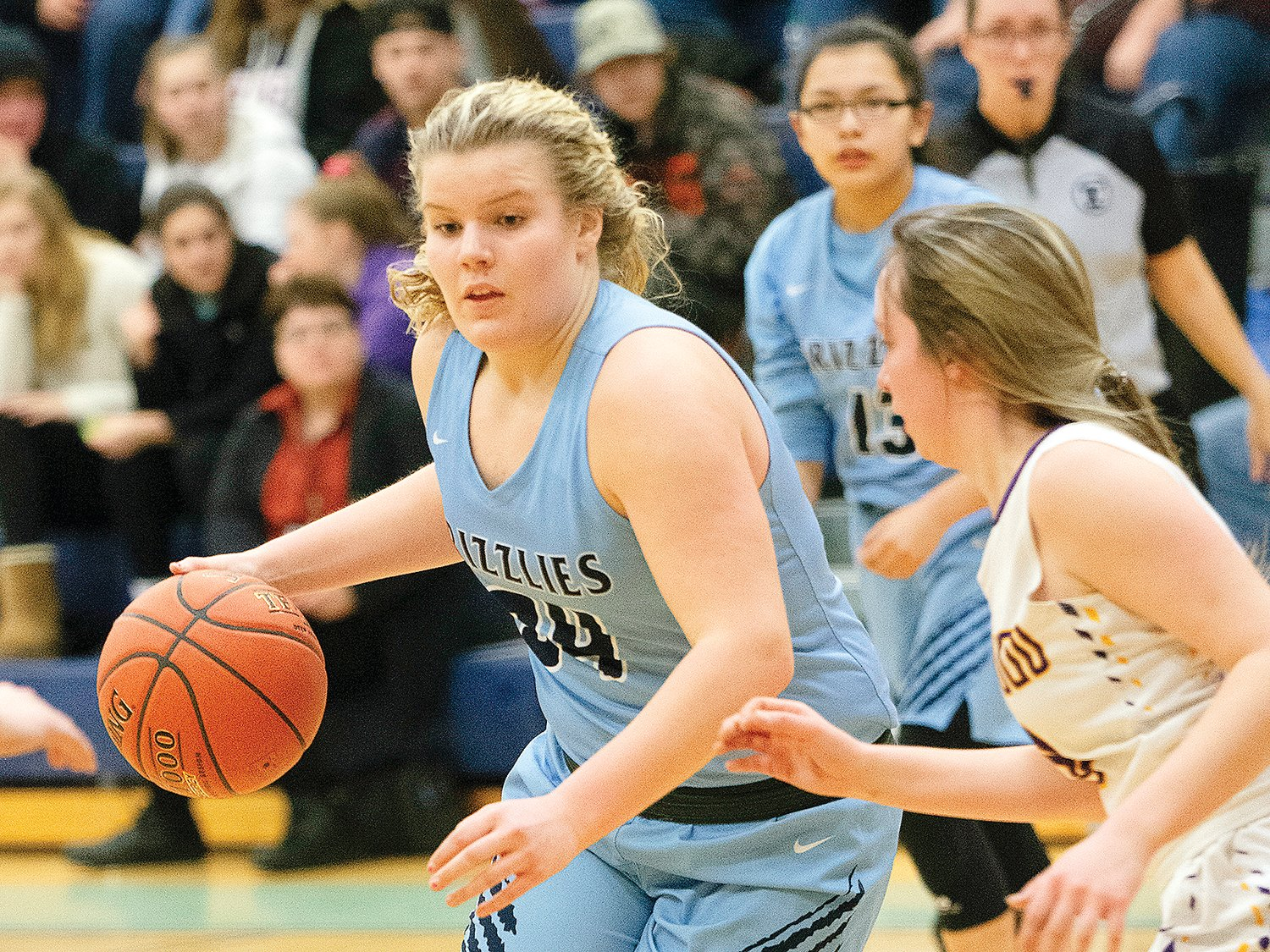 North Woods junior Brynn Simpson looks to work around a Floodwood defender as they closed out their regular season last Thursday.