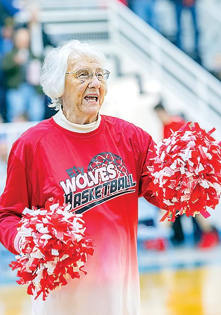 86-year-old Betty Kunstel, a 1951 Ely High School graduate, leads Ely faithful in a pregame cheer.