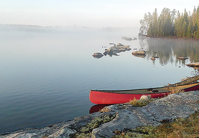 Morning mist on Bootleg Lake in the Boundary Waters Canoe Area Wilderness.
