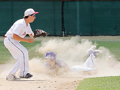 Ely's Jackson Levens waits for a throw while an Esko player kicks up dust with a slide to second.
