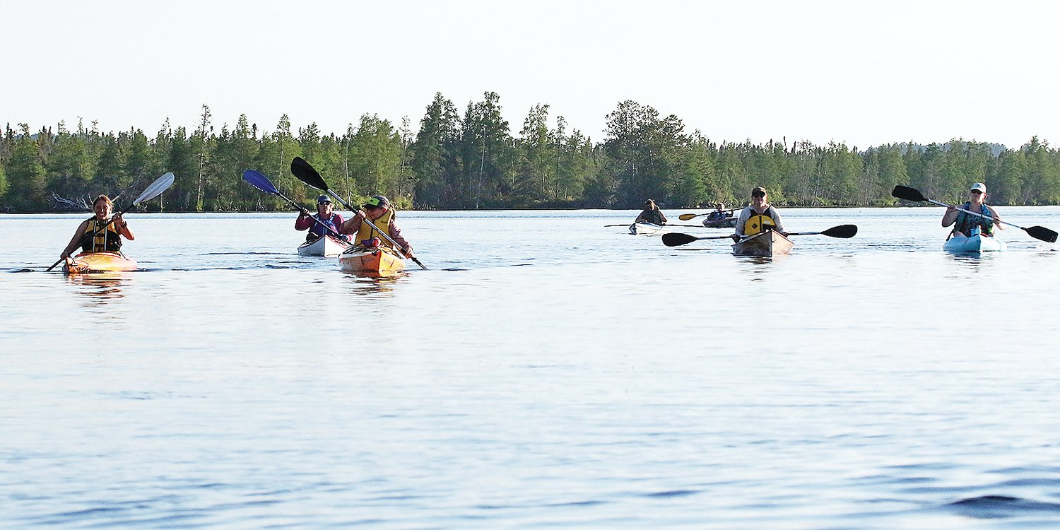 A flotilla of kayakers made their way across Lost Lake as part of an outing sponsored by Mesabi Outdoor Adventures.