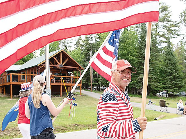 A big smile and lots of red, white, and blue at the Crane Lake parade.