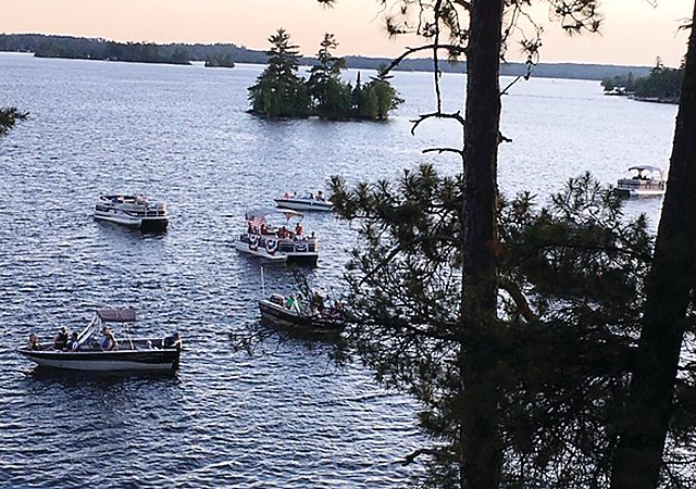 A scene from the Isle of Pines flotilla on Lake Vermilion.