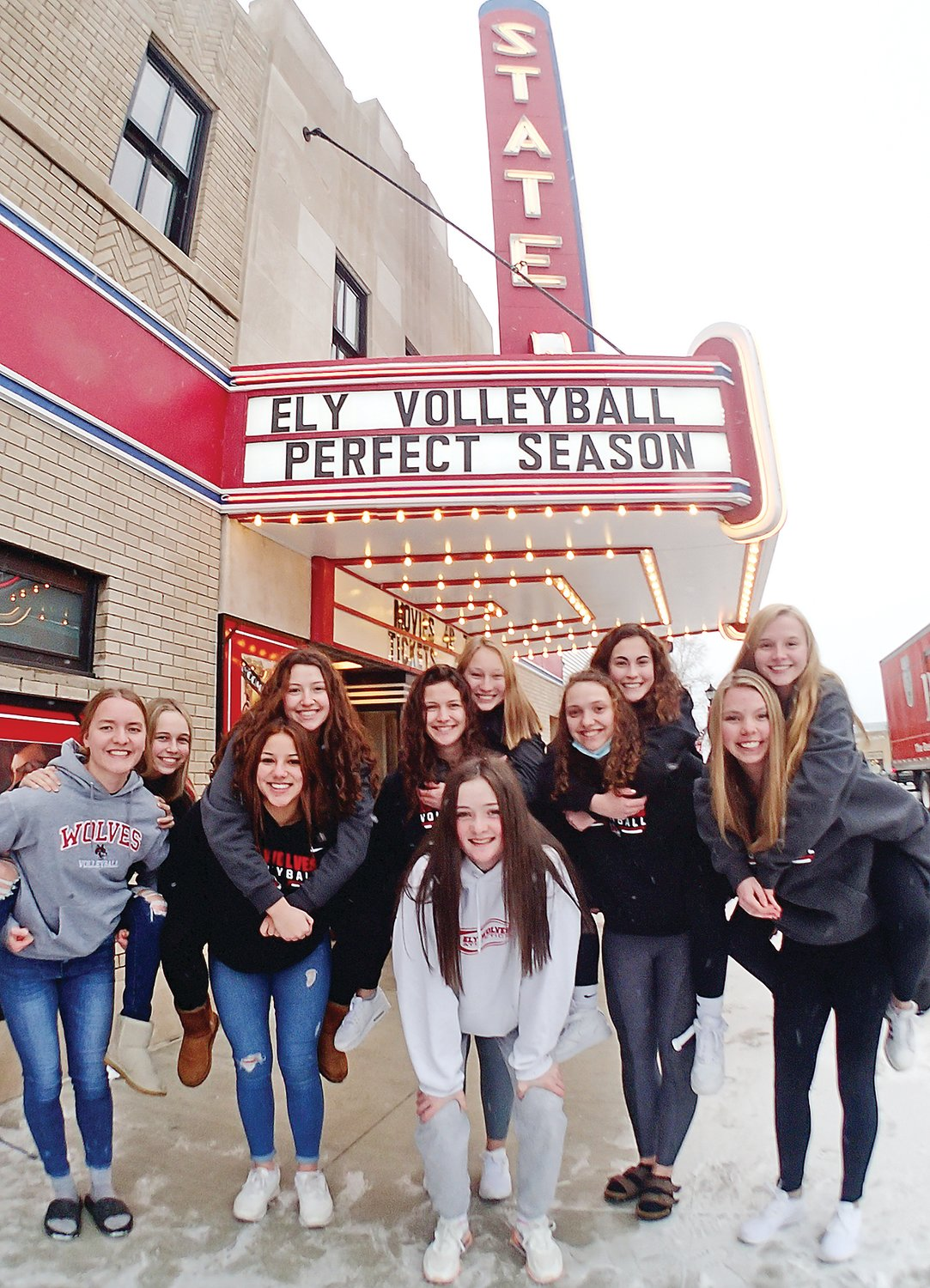 The Ely High School varsity girls volleyball team were honored at the Ely State Theater last week for going undefeated, with a perfect 12-0 record, for the season. With the play-offs canceled due to COVID-19 restrictions, the Timberwolves nonetheless relished their school record. Members of the team, McKenna Coughlin, Raven Sainio, Kate Coughlin, Katrina Seliskar, Annikka Mattson, Kellen Thomas, Courtney Eilrich, Madeline Kallberg, Rachel Coughlin, Madison Rohr and Charly Flom, gathered at the State Theater last Wednesday.
