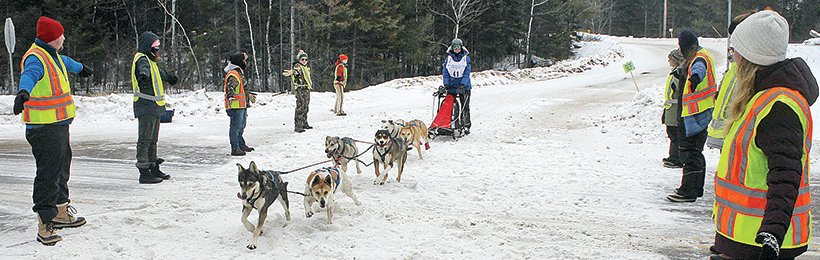 Volunteers kept Highway 21 open for mushers as they headed to Bear Head Lake State Park.