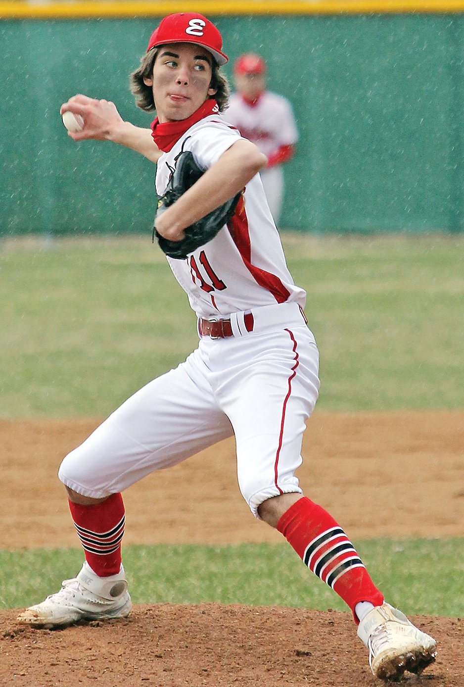 Ely's Mason Davis winds for a pitch.