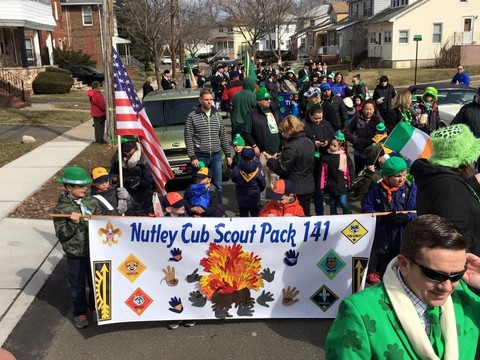 This photo shows the excitement of marching in the parade - as the Nutley Cub Scout Pack 141 wows the crowds. Photo from 2016. Courtesy of Linda Buset.