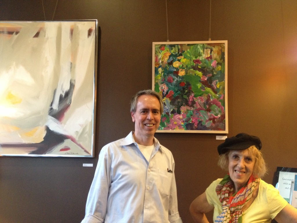 "Joe Thorton, owner of Elements Montclair, is an art lover and displays local art in the this Montclair spot. With him is the ebullient artist Susan Marx, who says she ""inherited the soul of Monet""."