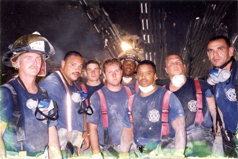 On 9/11/01 - members of the Montclair Fire Department at Ground Zero.MFD 911 l to r: Capt Tim Selleck (retired), FF Mario Sierra, FF David Hayes (left MFD for FDNY), FF Chris Meletta, FF Daryl Pearman, FF Pat Fraiser, FF Steve Wavrek (retired), FF Lloyd Gialanella. Courtesy of MFD