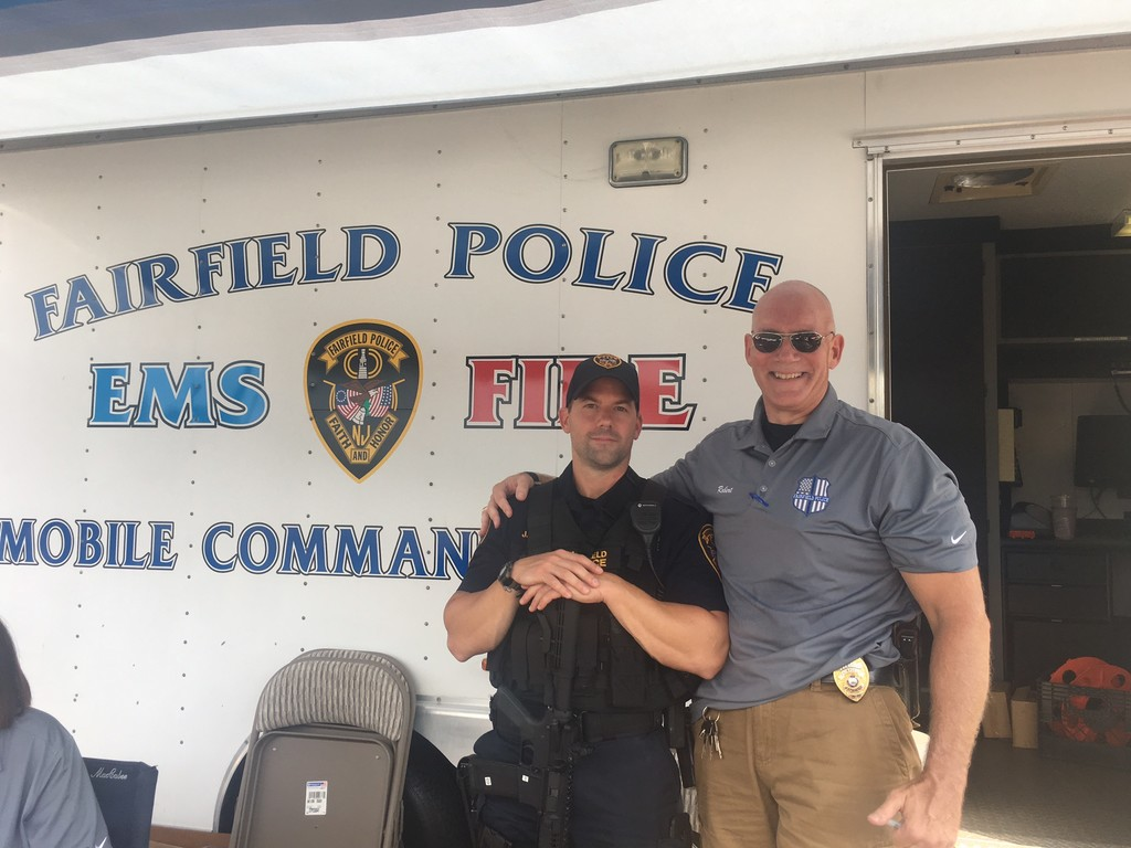 FROM LEFT TO RIGHT AT THE FAIRFIELD POLICE NATIONAL NIGHT OUT EVENT: Fairfield Police Detective Jeffrey Didyk and Fairfield Police Detective Robert Sanger.