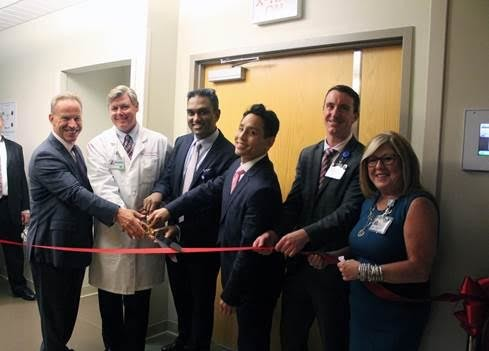 From left to right: Robert Heary, M.D., Neurosurgeon, Raymond Holmes, M.D., Vascular Surgeon, Ankitkumar Patel, M.D., Medical Director Cardiac Cath Lab; Harold Kim, M.D., Cardiologist, Tim O'Brien, Chief Operating Officer, Heather Farrell, Director Cardiovascular Services