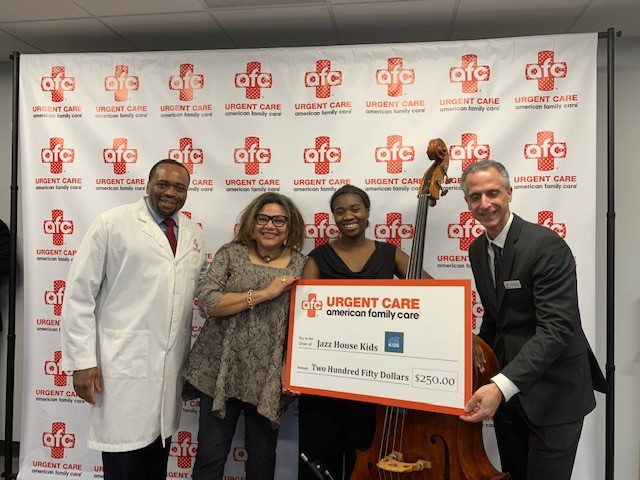 Caption left to right: AFC Medical Director Dr. Avery Browne; Jazz House Kids Executive Director Melissa Walker; Bassist Caylen Bryant and AFC CEO Albert Saad