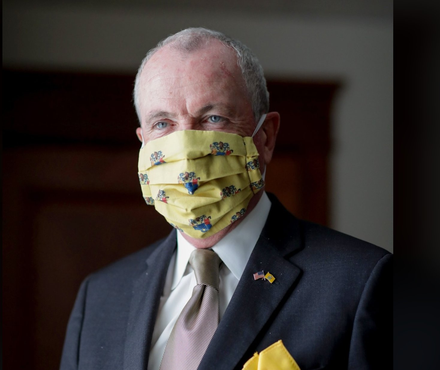 Governor Murphy sports a matching and optimistic yellow pocket square and mask.