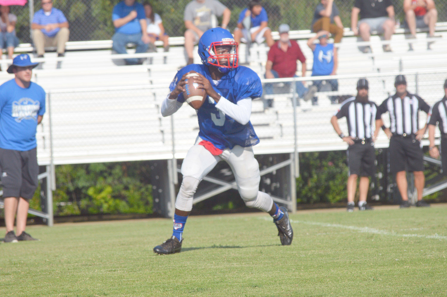 Trey Berry (3) rolls out to throw a pass in Quitman's scrimmage against Hawkins last Thursday.