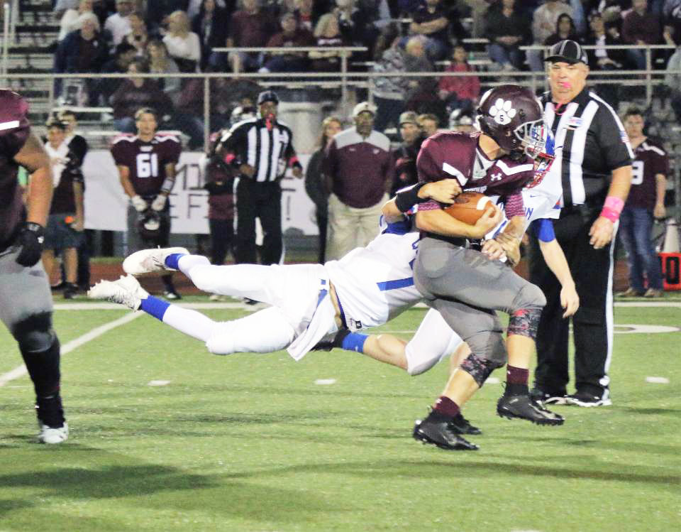 Quitman's Mason Reynolds (7) makes a big stop in his varsity debut against Troup Friday night.
