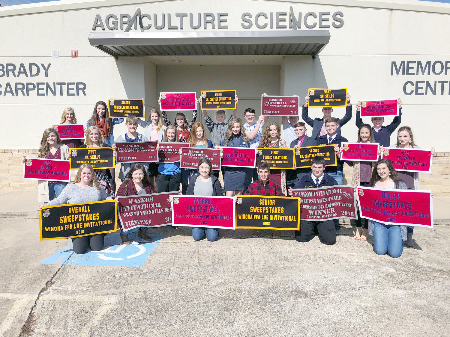Quitman FFA students stand with the flags they won this semester.  (Photo from Quitman FFA)