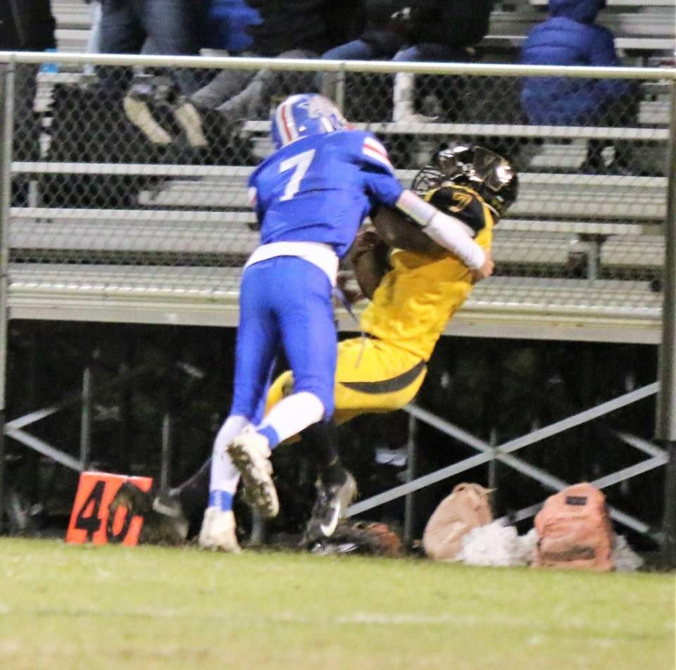 Quitman freshman Mason Reynolds makes a great stop on a Winona running back in Friday's game. (Photo by Sheree Phillips)