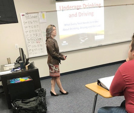Quitman Municipal Court Clerk and Associate Judge Lauren Maynard gave a presentation on the dangers of underage drinking and driving to Coach Vincent Rapp's senior government class. (Photo from City of Quitman)