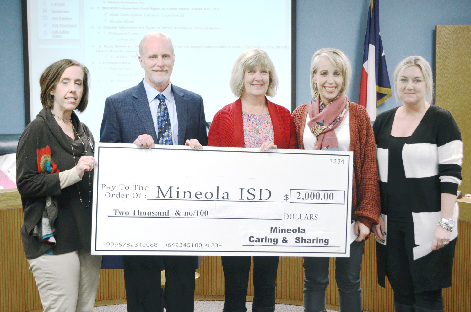 Caring & Sharing of Mineola made a $2,000 donation to the Mineola Independent School District at the Nov. 26 school board meeting. Each campus received $500 and the money will be placed in a benevolent fund for field trip fees, school supplies, clothing, shoes, and other supplies that students need. The district's four principals accepted the contribution. From left is Stacy Morris (Elementary School), David Sauer (High School), Becky Moore of Caring & Sharing, Kendall Gould (Middle School), and Jole Ray (Primary School). (Monitor photo by Hank Murphy).