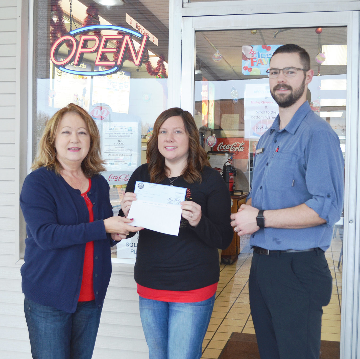Rebecca Bohannan, center, was the winner of $500 from the Shop Local Mineola campaign. While shopping in downtown Mineola, she visited Dairy Queen and her receipt was the first one drawn as part of this year's contest. Also pictured is Doris Newman, director of the Mineola Main Street program, and Dairy Queen owner Daniel Tucker. The campaign covers purchases made between Nov. 23 and Dec. 28.