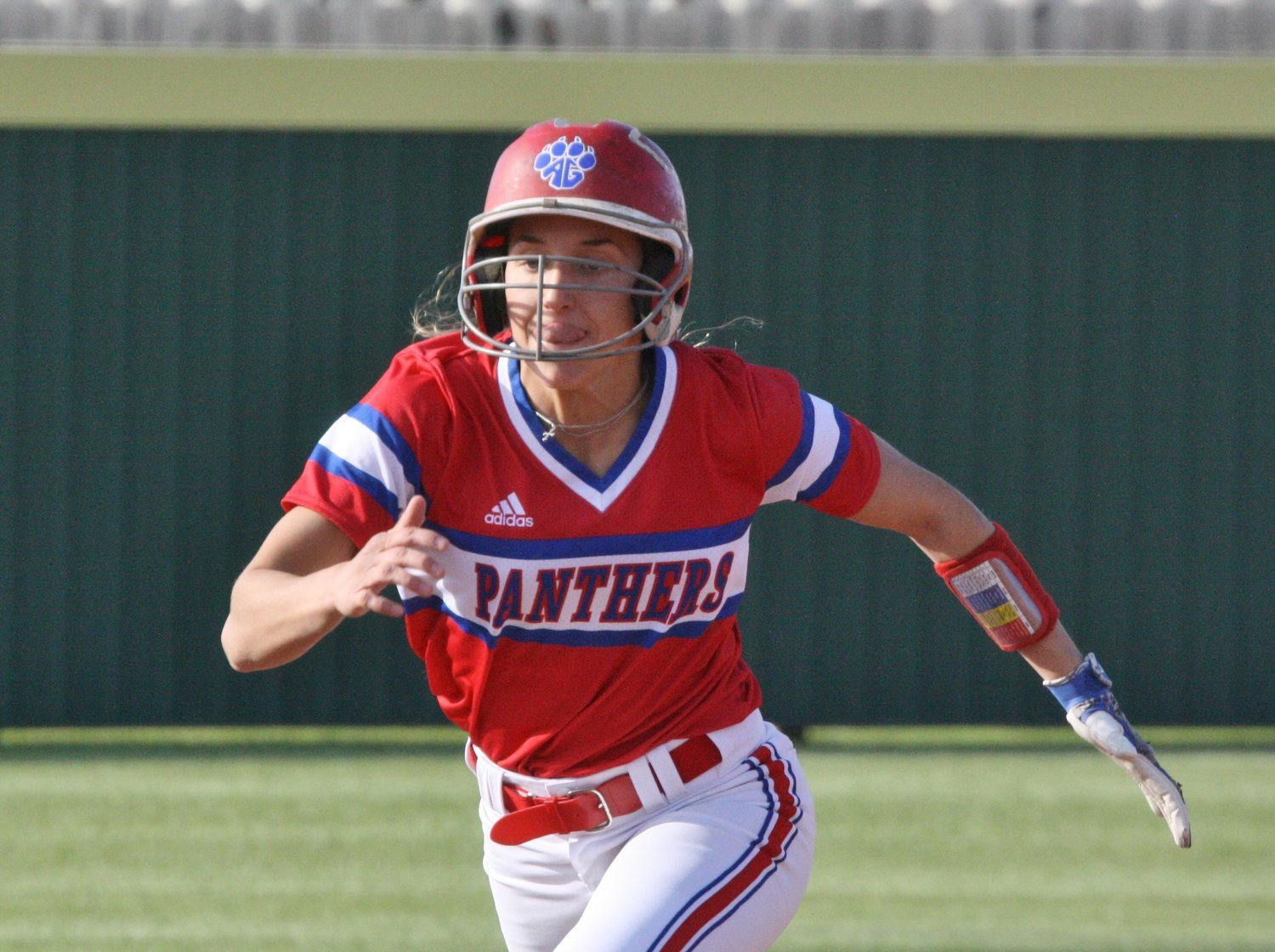 Lady Panther Ashlyn Rogers takes off from second on a successful attempt to steal third base.
