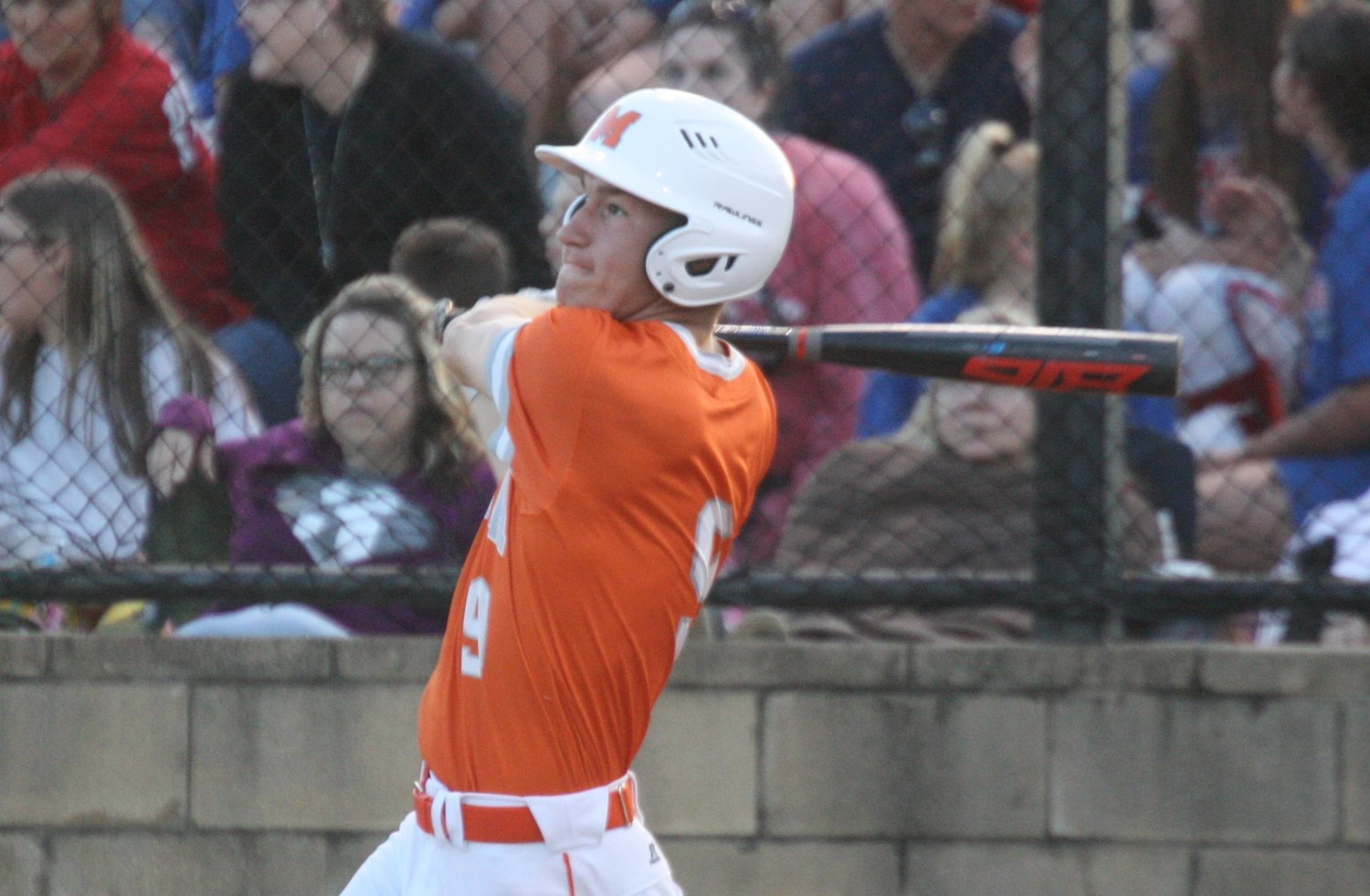 Mineola's Cole Castleberry belts a run-scoring triple in the third inning against Alba-Golden.