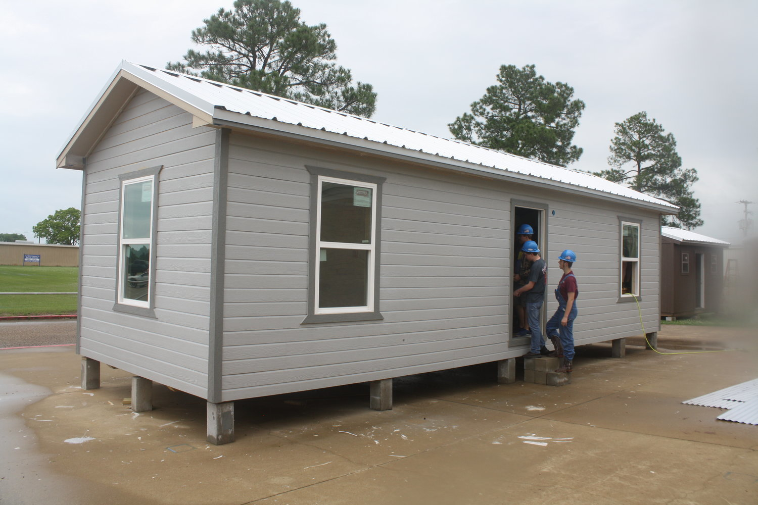 "The tiny house is being built by Quitman High School ""Geometry in Construction"" at the back of the high school campus."