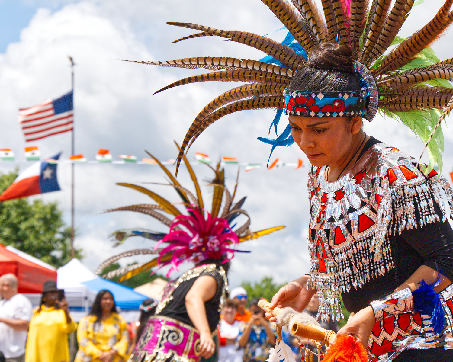 Aztec dancer Maria Sausana performs Danza de Matachines on Saturday in downtown Mineola during May Fiesta Day.