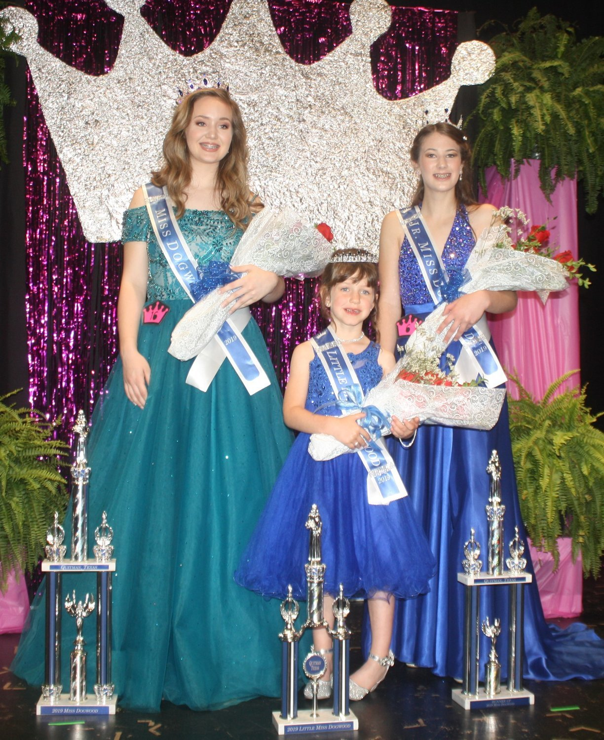 The 2019 Dogwood Queens together on stage with their flowers and trophies. Miss Dogwood Lucy Brannon (left) Little Miss Dogwood Karley Kernes (middle) and Junior Miss Dogwood Kameran Farnham.