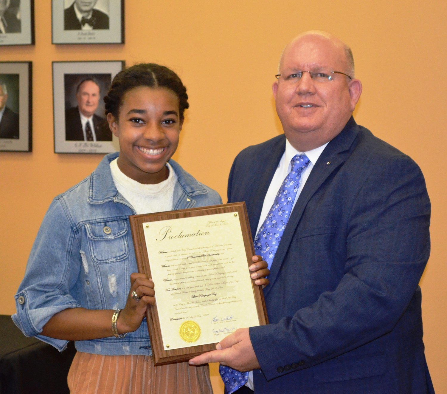 Mineola Mayor Kevin White presents a proclamation to Mineola High School's Abeni Kratzmeyer at Monday's Mineola City Council meeting in recognition of her second class 3A state pole vaulting title. White proclaimed Monday, May 20 as Abeni Kratzmeyer Day in Mineola.
