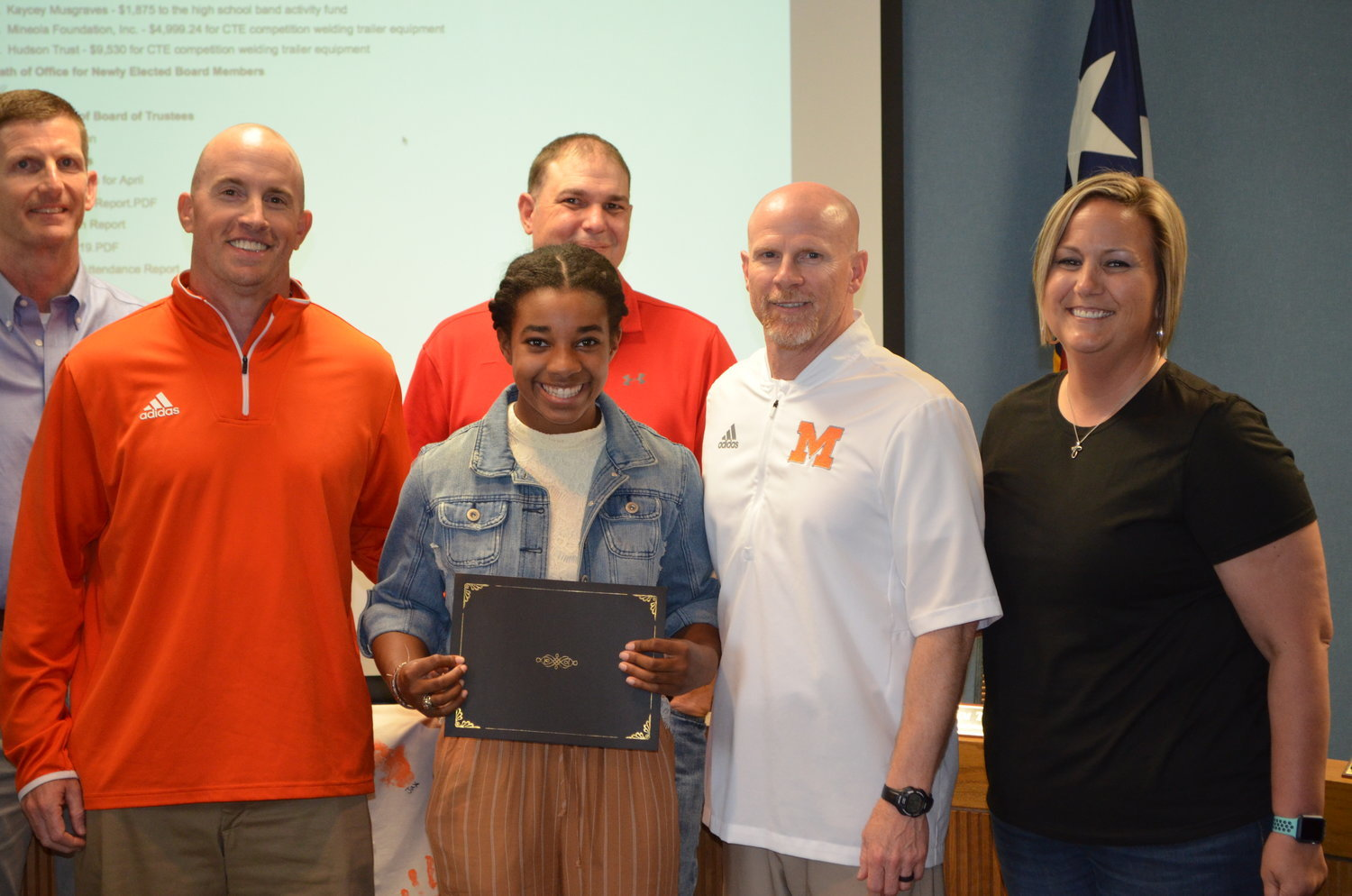 Abeni Kratzmeyer was recognized at Monday night's MISD school board meeting for her accomplishment in repeating as class 3A state pole vault champion. Her coaches described her as a dedicated athlete as well as fine student and an exceptional person. From left are school Trustee Kyle Gully, athletic director Luke Blackwell, Kratzmeyer, Trustee Daniel Louderman, coach Bill Self, and coach Kerry Van Cleave.
