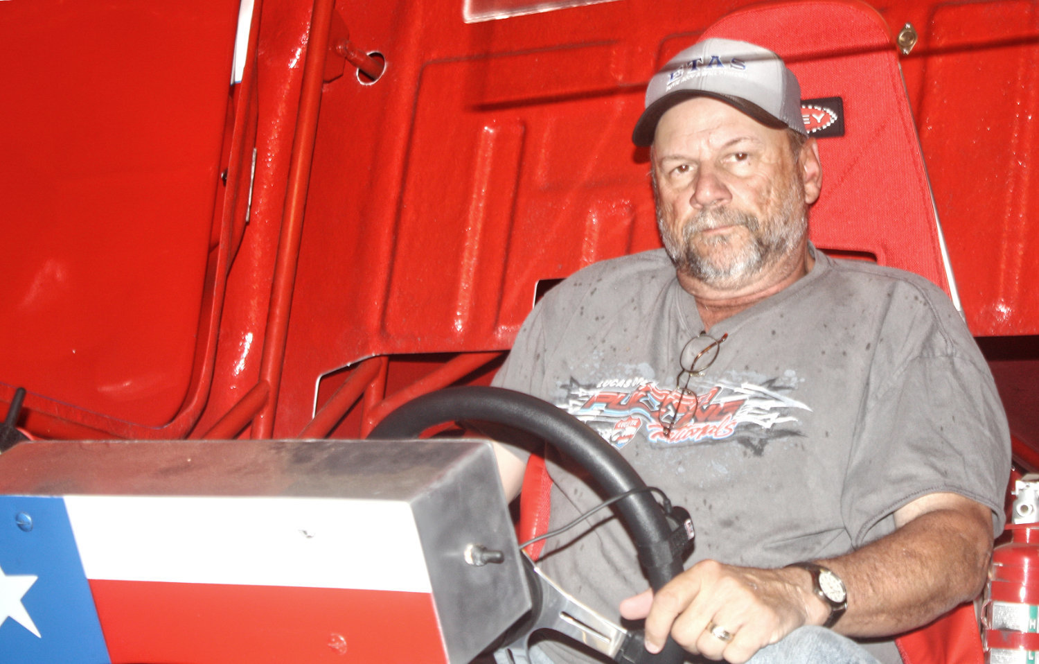 Charlie Hinds of Quitman sits behind the wheel of his pulling truck.