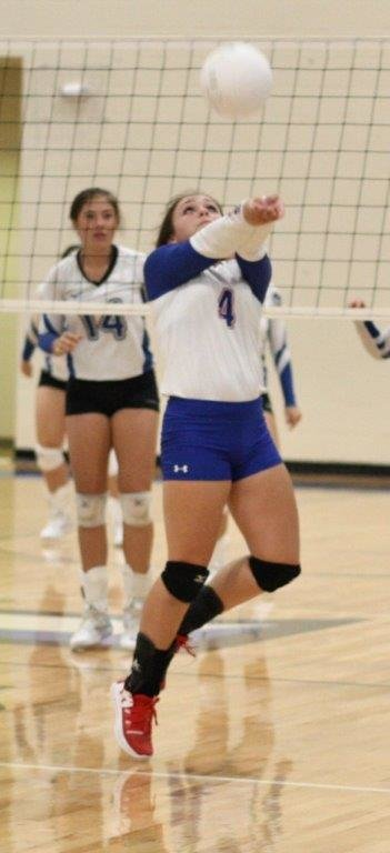 Lady Panther Bralee Littlejohn sets the ball in action against Hawkins.